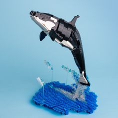 Orca — BrickNerd - Your place for all things LEGO and the LEGO fan community Lego Moc, Lego Duplo, Geek Cave, Dolphin Family, Lego Sculptures, Lego Club, Lego Boards, Lego Craft, Cool Lego Creations