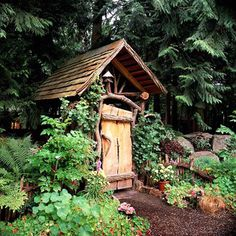 Backyard Landscaping Ideas: Garden Structures Rustic Entrance Structure:   A natural entrance! This rustic, handcrafted garden structure features tree limbs and branches as part of the design. The rough-hewn door opens to the entryway to a garden. A shake-shingle pitched roof tops the structure.