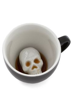 Will's Presentation Skulls Mug - Black, White, Quirky, TThis mug stirs up a smile with one of Will's favorite sketching subjects and style trends – a skeleton's cranium, which is buried beneath the surface of your coffee or tea. Captivate your audience in cool Will-inspired style by punctuating your speech with sips from this microwave- and dishwasher-safe design!.