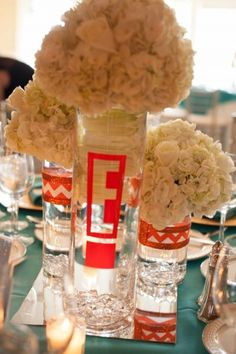 "Bat Mitzvah centerpieces for an ""E! Emma-tainment"" theme."