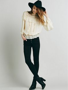 Tip of the Day: How to Make a Victorian Top Look Modern via @WhoWhatWear // Free People Embroidered Victorian Ruffle Top