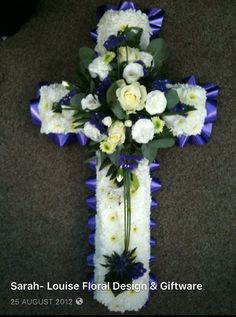 Cross funeral flowers/ tribute