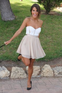 This dress makes me want to be tan and brunette too.  Not sure how good this would look on a blonde