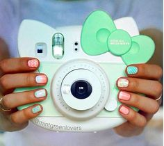 Mint green hello kitty instax camera! I wish they had a baby blue one