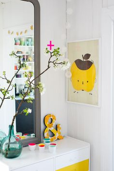 Cute little corner with a single flowering branch that ties it all together. Yellow apple just balanced by touch of yellow beneath. bywstudent