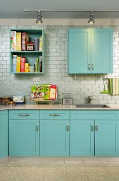 Turquoise cabinets in bathroom