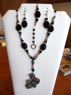 A stunning Lariat necklace and earrings and beacelet set.