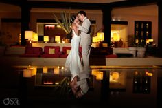 Newlyweds at a destination wedding in the Riviera Maya at the Ocean Coral and Turquesa Resort in Puerto Morelos. Mexico wedding photographers Del Sol Photography.