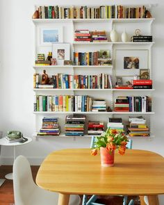 A CUP OF JO: Our Brooklyn apartment - This bookcase is from the container store. I really like how they broke up a couple of the shelves to give the layout more interest. Maybe we could purchase the hardware and use wood planks for the shelving? Brooklyn Apartment, Home Living Room, Interior, Bookshelves Diy, Home, Apartment Inspiration, Interior Design, Home And Living, Home Library
