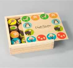 """Woodland Memory Game PRODUCT INFO:   A childhood essential re-imagined for the next generation, with playful icons and patterns. Solid and engineered wood. Lead free, non-toxic. Recommended ages: 2+ years. This product uses non-toxic dyes and meets or exceeds U.S. toy testing standards.    Set contains 16 cylinder pcs (1.75"""" H x 1.75"""" diameter).   Box size: 8"""" W x 8"""" L x 2"""" H."""