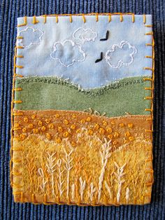 quilting piece, blanket stitch edges. bullion knots and feather stitches and seed stitched. love the colours