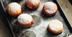 Take a bite of these delicious home-made doughnuts filled with sweet strawberry jam. Be careful, they can be very hot!