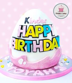 A girly pink kinder surprise birthday cake