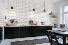 Visual--white subway tiles up to high ceiling (w/dark grout and black cabinets)
