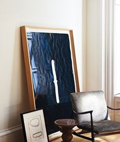 For an effortless, sophisticated vibe, lean a large piece in a quiet corner. Plexiglas won't break if knocked over, but because big art is heavy, this is only for toddler-free homes.