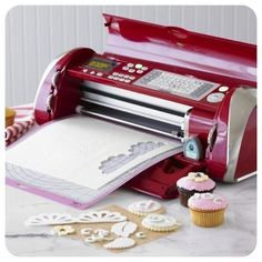 Create professional-looking cakes, cupcakes, cookies is as easy as pushing a button, thanks to the Cricut Cake Decorating Machine. This electronic cutter quickly trims sheets of gum paste, fondant or frosting into the shapes you choose. Cricut Cake, Cake Decorating Tools, Cookie Decorating, Cake Cookies, Cupcake Cakes, Baking Gadgets, Kitchen Gadgets, Cake Machine, Cutter Machine