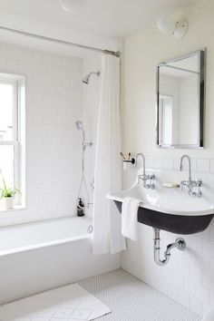 The kid's bathroom on the second floor is lined with white penny tile and white square tiles in a running bond pattern. The wallpaper is from Juju papers. Bathroom Tile Designs, Bathroom Floor Tiles, Wall Tiles, Bathroom Ideas, Bathroom Wallpaper, Trough Sink Bathroom, Kohler Sink, Concrete Bathroom, Shower Tiles