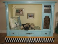 I definitely need to make one of these. I need to find something with drawers on the side for their stuff.  Large Upcycled Pet Bed House from Vintage TV. $397.00, via Etsy.