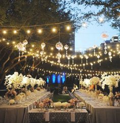 Gorgeous outdoor wedding or party setting. Love the lighting!