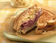 Reuben Sandwiches a favorite of mine, try for St Pats Day lunch, 520cal a serv, 33 g fat, corned Beef and sauerkraut on grilled rye bread with swiss cheese and dressing