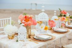 Wedding centerpieces idea for an outdoor beach wedding reception. This is lovely and truly beautiful. We love everything about this and we cannot take our eye off of those gold plate chargers.