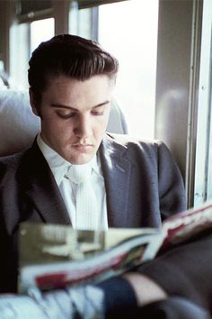 Elvis Presley on the train to Memphis, July 4, 1956. Photo by Alfred Wertheimer.
