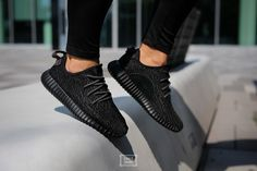 Yeezy X Adidas 2016 Pirate Black 350 Boost Sneakers $725 From the Spring 2016 Collection. Men's black Primeknit Yeezy for Adidas Pirate Black Boost 350 round-toe low-top sneakers with pull tab at counters, ribbed rubber outsoles, Boost Tech soles and lace tie closures. Includes box. As seen on Michael B. Jordan.