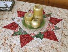 The table topper is machine pieced and machine quilted.  Traditional Christmas colors with gold accents.  This table topper will look great anywhere in your home.  Made with 100% cotton fabrics with 100% cotton batting in a smoke-free home.  Size: 20 inches across the straight sides  22,75 inches across the points