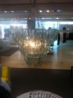 Bottle top chandelier. So cool!
