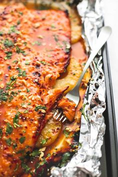 Baked Thai pineapple salmon in foil is an easy and healthy 30 minute salmon dish with a sweet and spicy sauce and juicy pineapple.