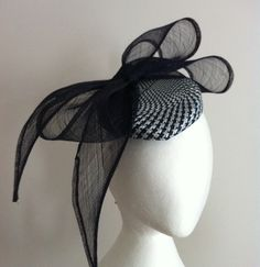 Navy and white hat by mark Garvie millinery