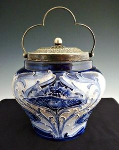 Biscuit jar designed by William Moorcroft while working for James MacIntyre and Co. Ltd. This is Florian Ware which was made just a short time. This particular piece; based on registration mark was produced between 1900-1906.