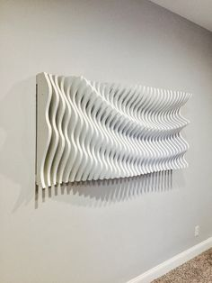 This parametric wall wave is a visually intriguing piece of wall art. Comprised of 34 individually cut pieces of Oak plywood that spaces apart to displays a sweeping and organic wave. This piece is 58 long, 28 wide, and 8 thick at its thickest. Art Mural 3d, Grand Art Mural, 3d Art, 3d Wall Art, Artwork Wall, Wood Wall Art Decor, Large Wood Wall Art, Wood Sculpture, Wall Sculptures