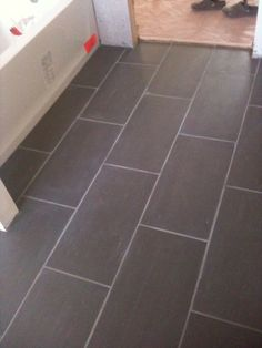 Tiles Bathroom Floor 6x24 planking tile layout. looks like hardwood but is much more