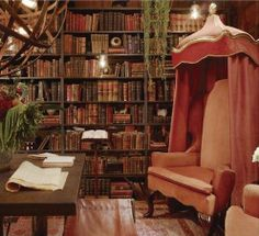 The perfect chair in the perfect library. I trust there is a fireplace. Not a bad idea for a chair in a bedroom. Cozy.