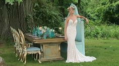 Confident bride wearing a stunning Ashley and Justin gown standing with our beautiful vintage glam table @waverleyandgrandevents