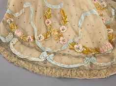 Doucet again! I am in a Doucet mood today...Ball gown of ca. 1902 embroidered with silk ribbon flowers with a little accents of Bouillion thread and silver sequins....