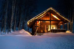 Rustic Cabin in the Winter! Love the Christmas lights!