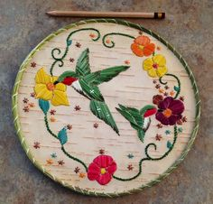 Another piece I made.  Mother and baby hummingbirds with flowers.