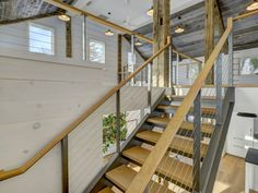 Steel channel staircase with cable rail leading to the loft