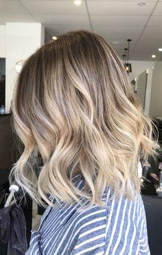 Lived in hair colour Blonde bronde brunette golden tones Balayage face framing blonde Textured curls short hair lob