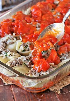 Spooning Sauce Over Pan of Ground Beef Stuffed Shells Image Ground Beef Stuffed Shells, Stuffed Shells With Meat, Stuffed Shells Recipe, Stuffed Pasta Shells, Dinner Dishes, Food Dishes, Ground Beef Seasoning, Spinach Lasagna Rolls, Jumbo Pasta Shells