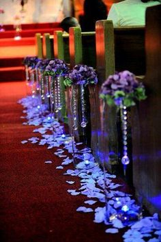 Crystal and floral ceremony aisle decor.
