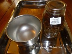 Here's a basic tincture set up: a stainless tray to catch spills, and a stainless bowl for the strained tincture.