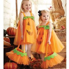 Pumpkin dress features jack 'o lantern face applique over tulle overlay, jersey…