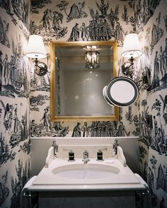 21 Perfect Powder Room Wallpaper Ideas: Traditionalists, get ready to swoon. The intensity of toile is perfect in this narrow space.