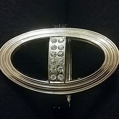 Gold toned bracelet with diamond like gems Gold toned. Opens up with hinged clasp. Top of bracelet has 6 diamond like gems. Not diamonds but not sure what they are exactly Jewelry Bracelets