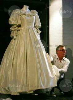 According the the Putnam Museum, Davenport, Iowa, there are only two people in the world allowed to handle Diana's wedding dress.  They appeared when the dress arrived at the museum and arrived when the exhibit was dismantled and traveled with it to the next venue to set it up again.  My request to observe the dismantling was turned down.