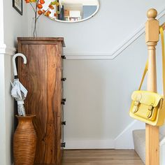 In this traditional hallway an off-white was used below the dado rail for a slight contrast to the stark white above.