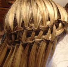 someone tech me how to do this. I ca. Hardly do one waterfall braid but this is double the trouble .